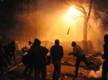 Protesters throwing pieces of paving during and metal tubes at riot police during clashes at Bankova str, Kiev, Ukraine. December 1, 2013.
